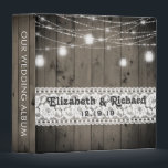 """Mason Jar String Lights Lace Rustic Wedding Album Binder<br><div class=""""desc"""">Country chic, rustic wood, mason jar lights, and vintage lace wedding album binder- Elegant, rustic country wood lace monogrammed wedding keepsake with rustic, grayed barn wood planks background and darkened edges. Country mason jar string lights are draped across the top with a twinkling and glowing effect. A strip of vintage,...</div>"""