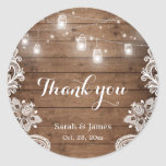 "Mason Jars Lights Lace Rustic Wood Wedding Favor Classic Round Sticker<br><div class=""desc"">Mason Jars Lights Lace Rustic Wood Wedding Favor Thank You Sticker. (1) For further customization,  please click the ""customize further"" link and use our design tool to modify this template.  (2) If you need help or matching items,  please contact me.</div>"