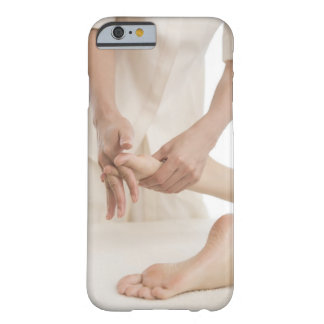 Massage therapist applying foot massage 2 barely there iPhone 6 case