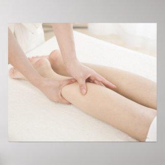 Massage therapist applying foot massage poster