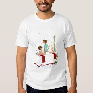 Massage therapist massaging a woman lying on a shirt