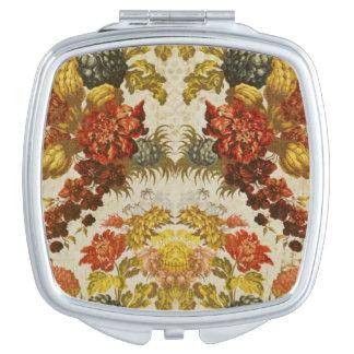 Materia textil con un estampado de flores de repet espejos compactos