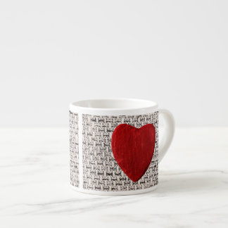 Material background with heart espresso cup