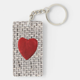 Material background with heart keychain