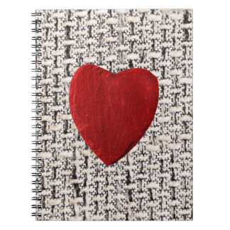 Material background with heart notebook