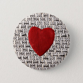 Material background with heart pinback button