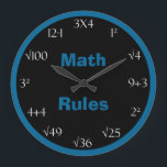 """Math Problem Classroom Clock - Math Rules<br><div class=""""desc"""">Looking for a math problem clock? This great math wall clock features the words &quot;Math Rules&quot; in blue on a black background in the center with a coordinating blue border. The numbers on the clock are printed in white and there are math problems which must be solved in order to...</div>"""