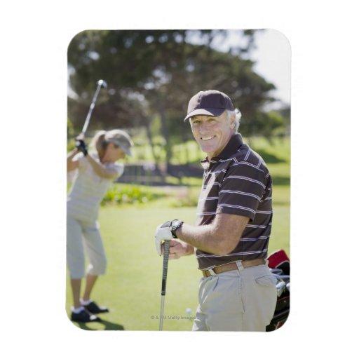 Mature couple playing golf vinyl magnet