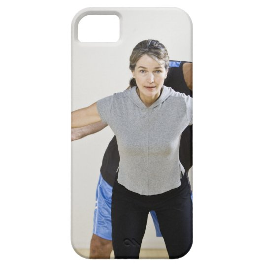 Mature man assisting woman, exercising using iPhone SE/5/5s case