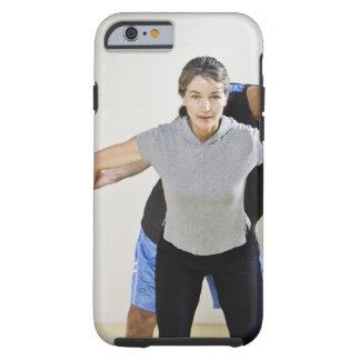Mature man assisting woman, exercising using tough iPhone 6 case