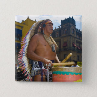Mature man playing drums with drumstick, Zocalo, Button