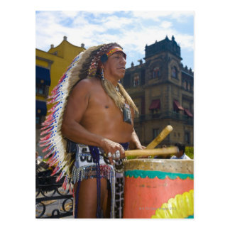 Mature man playing drums with drumstick, Zocalo, Postcard
