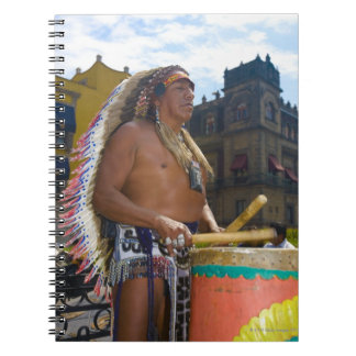 Mature man playing drums with drumstick, Zocalo, Spiral Notebook