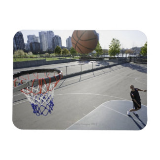 mature man shooting basketball magnet