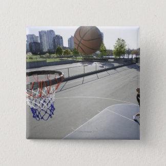 mature man shooting basketball pinback button