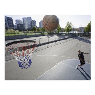mature man shooting basketball postcard