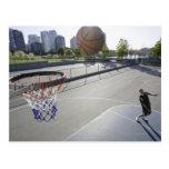 mature man shooting basketball postcards