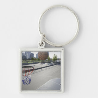 mature man shooting basketball Silver-Colored square keychain