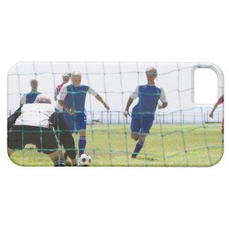 mature men kicking soccer ball towards iPhone SE/5/5s case