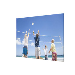 Mature men leaping for volley ball on beach, canvas print