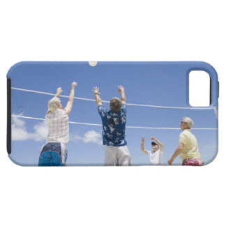 Mature men leaping for volley ball on beach, iPhone 5 cover