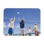 Mature men leaping for volley ball on beach, flexible magnets