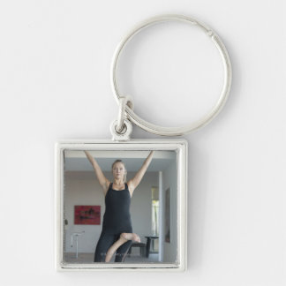 Mature woman exercising 2 keychain