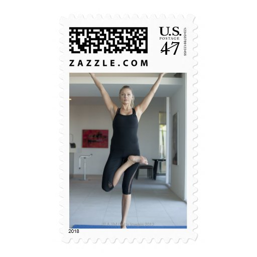 Mature woman exercising 2 postage stamp
