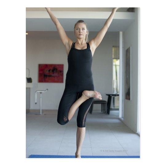 Mature woman exercising 2 postcard
