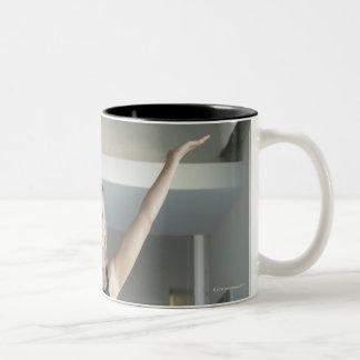 Mature woman exercising 2 Two-Tone coffee mug