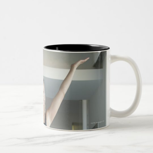Mature woman exercising 2 Two-Tone coffee mug