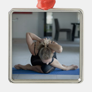 Mature woman exercising 3 square metal christmas ornament