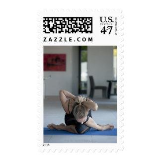 Mature woman exercising 3 stamp