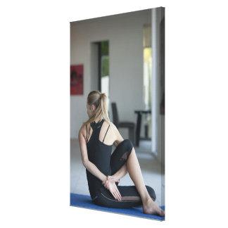 Mature woman exercising 4 canvas print
