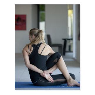 Mature woman exercising 4 postcard