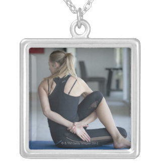 Mature woman exercising 4 silver plated necklace