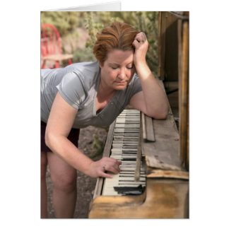 Mature Woman Playing Antique Wooden Piano in Deser Card