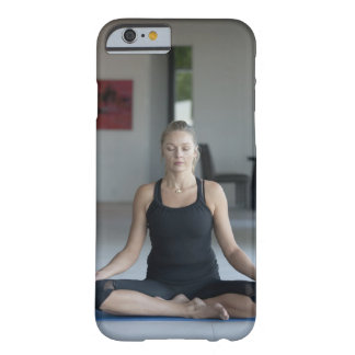 Mature woman practicing yoga barely there iPhone 6 case