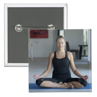 Mature woman practicing yoga 2 inch square button