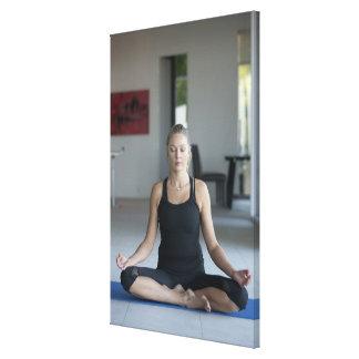 Mature woman practicing yoga canvas print