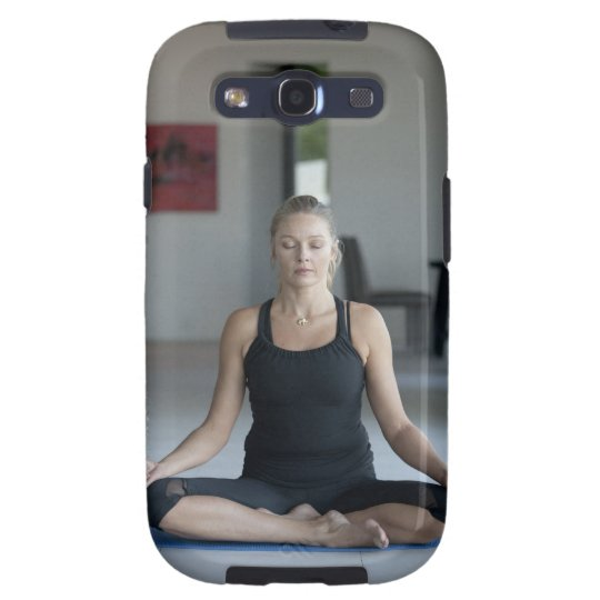 Mature woman practicing yoga galaxy s3 cover