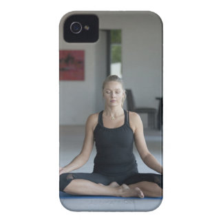 Mature woman practicing yoga iPhone 4 cover