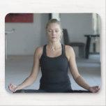 Mature woman practicing yoga mousepads