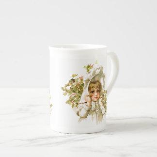 Maud Humphrey: Autumn Girl with Holly Tea Cup