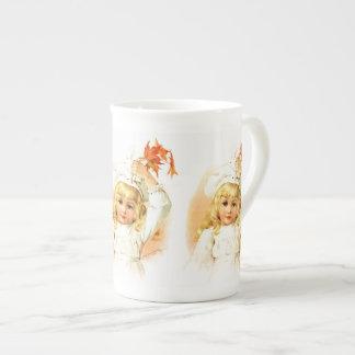 Maud Humphrey: Autumn Girl with Maple Leafs Tea Cup