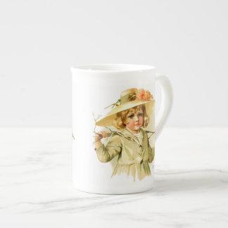 Maud Humphrey: Winter Girl with Branch Tea Cup