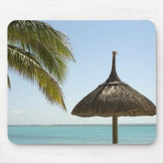 Mauritius. Idyllic beach scene with umbrella Mouse Pad