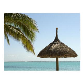 Mauritius. Idyllic beach scene with umbrella Postcard
