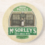 "McSorley&#39;s Drink Coaster<br><div class=""desc"">A vintage Irish Pale Ale advertisement featuring a tavern keeper standing in fron of the establishment. McSorley&#39;s established in 1854.</div>"
