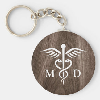 MD medical doctor with caduceus on wood background Keychain